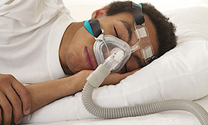Person sleeping with CPAP