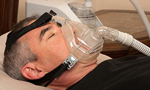 Sleep Apnea link - man wearing mask
